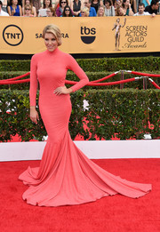 Charissa Thompson worked the SAG Awards red carpet in an eye-catching pink turtleneck mermaid gown.