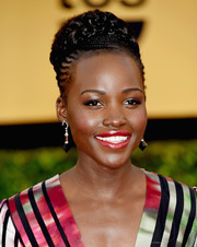For the SAG Awards, Lupita Nyong'o got a little more experimental with her hairstyle, wearing an updo consisting of multiple braids and cornrows.