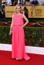 Amy Ryan brought an eye-catching pop of color to the SAG Awards red carpet with this layered hot-pink Honor gown.