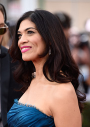 Laura Gomez wore her hair loose with curly ends during the SAG Awards.