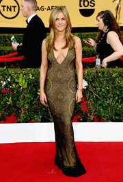 Jennifer Aniston brought the va-va-voom factor to the SAG Awards red carpet with this plunging, vintage John Galliano number in clingy black lace with a metallic gold underlay.