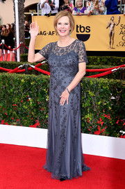 JoBeth Williams walked the SAG Awards red carpet wearing a floral-beaded slate-blue gown.