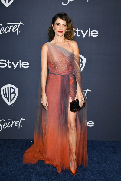 Nikki Reed rounded out her ensemble with a ribbed box clutch by Lala Lexa.