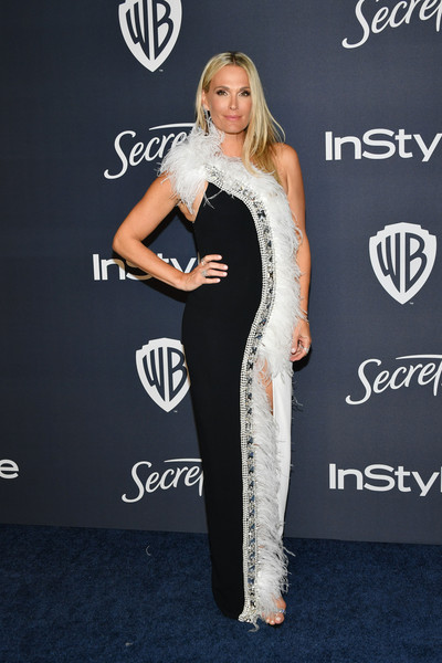 Molly Sims dazzled in a feather-embellished black-and-white one-shoulder gown by Pamella Roland at the Warner Bros. and InStyle Golden Globes after-party.