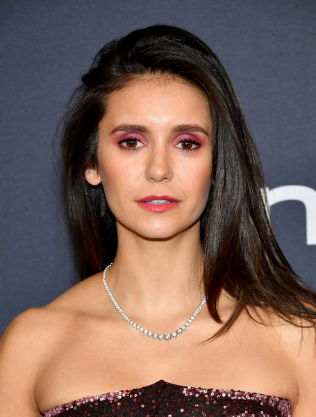 Nina Dobrev wore her hair in a straight side-parted 'do with a teased top at the Warner Bros. and InStyle Golden Globes after-party.