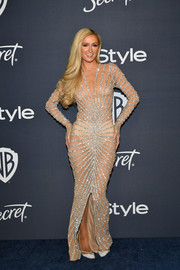 Paris Hilton bared her skin in a sheer, beaded gown Yousef Al-Jasmi at the Warner Bros. and InStyle Golden Globes after-party.