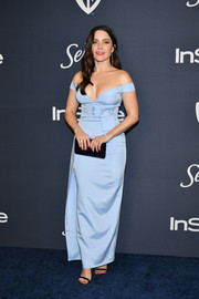 Sophia Bush paired her dress with a midnight-blue velvet clutch by Jimmy Choo.