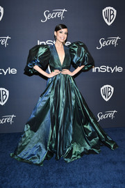 Sofia Carson made an unforgettable entrance in an iridescent green Elie Saab gown with a voluminous skirt and sleeves at the Warner Bros. and InSyle Golden Globes after-party.