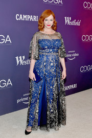 Christina Hendricks matched her dress with a blue box clutch.