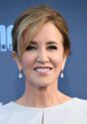 Felicity Huffman attended the Critics' Choice Awards wearing her hair in a loose side-parted bun.