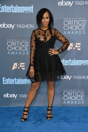 Kerry Washington went for an edgy-glam finish with a pair of black multi-strap satin sandals by SJP Collection.