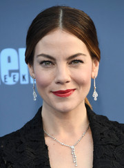 Michelle Monaghan swiped on some red lipstick for a pop of color to her dark look.