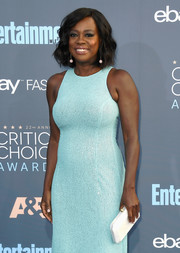 Viola Davis paired a white Tyler Ellis satin clutch with a turquoise sequin dress for her Critics' Choice Awards look.