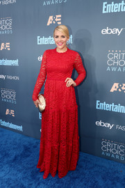 Busy Philipps punctuated her red dress with a gold frame clutch.