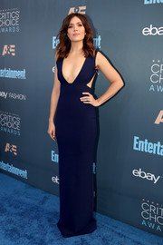 Mandy Moore flaunted her incredible figure at the Critics' Choice Awards in a fitted navy Solace London gown with a plunging neckline and waist cutouts.