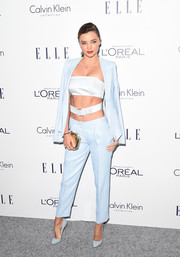 Miranda Kerr completed her all-blue outfit with a pair of Christian Louboutin pumps.
