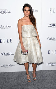 Nikki Reed paired her frock with laser-cut silver platform sandals by Bionda Castana.