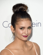 Nina Dobrev chose a lovely raspberry hue for her lips.