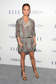 Alicia Vikander was rocker-chic in an embellished suede mini dress by her favorite brand, Louis Vuitton, at the Elle Women in Hollywood Awards.