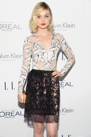Bella Heathcote arrived for the Elle Women in Hollywood Awards carrying a chic gold box clutch.