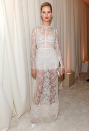 Karolina Kurkova went for subtle sexiness in a white lace evening dress by Elie Saab during the Elton John AIDS Foundation Oscar viewing party.