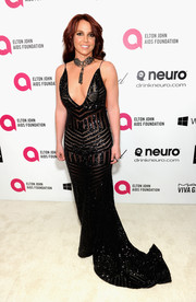 Britney Spears turned up the heat at the Elton John AIDS Foundation Oscar viewing party in a beaded black Michael Costello Couture gown with a cleavage-baring neckline.
