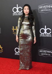 Awkwafina shone in a fitted gold gown by Romona Keveza at the 2018 Hollywood Film Awards.
