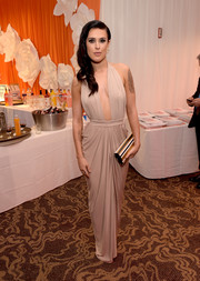 Rumer Willis chose a tricolor striped clutch to complement her gown.