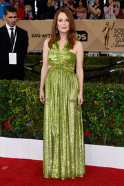 Julianne Moore was hard to miss at the SAG Awards in this Givenchy cutout gown rendered entirely in acid-green sequins.