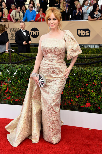 Christina Hendricks amped up the shimmer with a mirrored hard-case clutch.