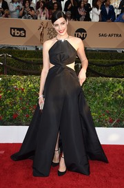 Jessica Pare went for ultra-modern glamour in a black halterneck cutout ball gown by Kaufmanfranco during the SAG Awards.