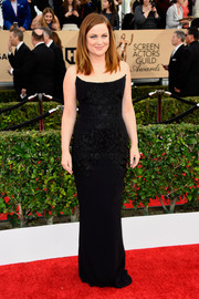 Amy Poehler exuded classic elegance at the SAG Awards in a strapless black Stella McCartney gown with tonal floral embroidery.