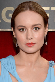 Brie Larson attended the SAG Awards wearing an elegant center-parted side chignon.