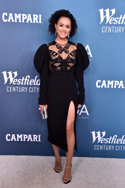 Nathalie Emmanuel added a bit of sparkle with a pair of bejeweled sandals by Jimmy Choo.