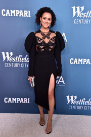 Nathalie Emmanuel looked gorgeous in a David Koma LBD with a sheer, butterfly-motif bodice and leg-o-mutton sleeves at the 2020 Costume Designers Guild Awards.
