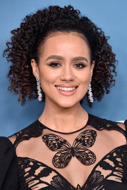Nathalie Emmanuel amped up the glam factor with a pair of dangling diamond earrings.