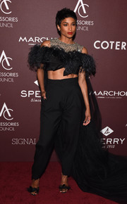 Ciara coordinated her look with a pair of feathered sandals.