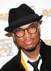 Ne-Yo paired his shades with a black fedora hat.