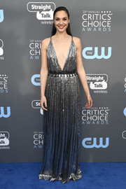 Gal Gadot was a vision in a silver Prada sequin gown with a deep-V neckline and a crisscross back at the 2018 Critics' Choice Awards.
