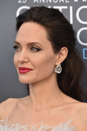 For her famous kissers, Angelina Jolie chose a bold red hue.