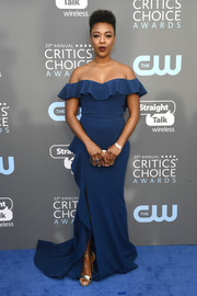 Samira Wiley looked fetching in a blue Rebecca Vallance off-the-shoulder gown with a ruffle neckline and a long train at the 2018 Critics' Choice Awards.