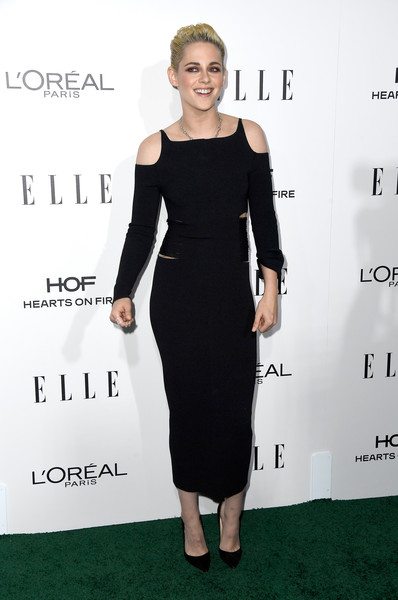 Kristen Stewart was characteristically edgy in a distressed cold-shoulder dress by Roberto Cavalli at the Elle Women in Hollywood Awards.