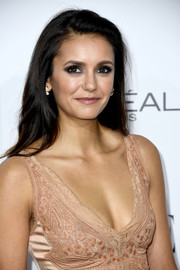 Nina Dobrev opted for a simple side-parted style when she attended the Elle Women in Hollywood Awards.
