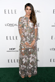 Nikki Reed finished off her look with a pearlized hard-case clutch.