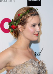Maggie Grace totally charmed with her crown braid, complete with a flower headband, during Elton John's Oscar-viewing party.
