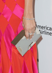 Camilla Belle accessorized with a modern-elegant Lee Savage box clutch at the Elton John AIDS Foundation Oscar-viewing party.