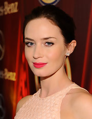 A bright fuchsia lipstick added color and fun to Emily Blunt's beauty look.