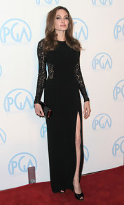 Angelina brought the heat in a lace cutout gown at the Producers Guild Awards.