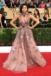 Taraji P. Henson caught plenty of admiring stares with this beaded sheer-bodice gown by Reem Acra at the SAG Awards.