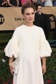 Natalie Portman coordinated a white Louboutin satin bow clutch with a puff-sleeved gown for the SAG Awards.